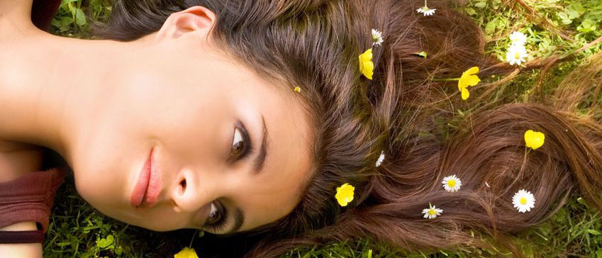 pretty woman laying down with flowers in hair