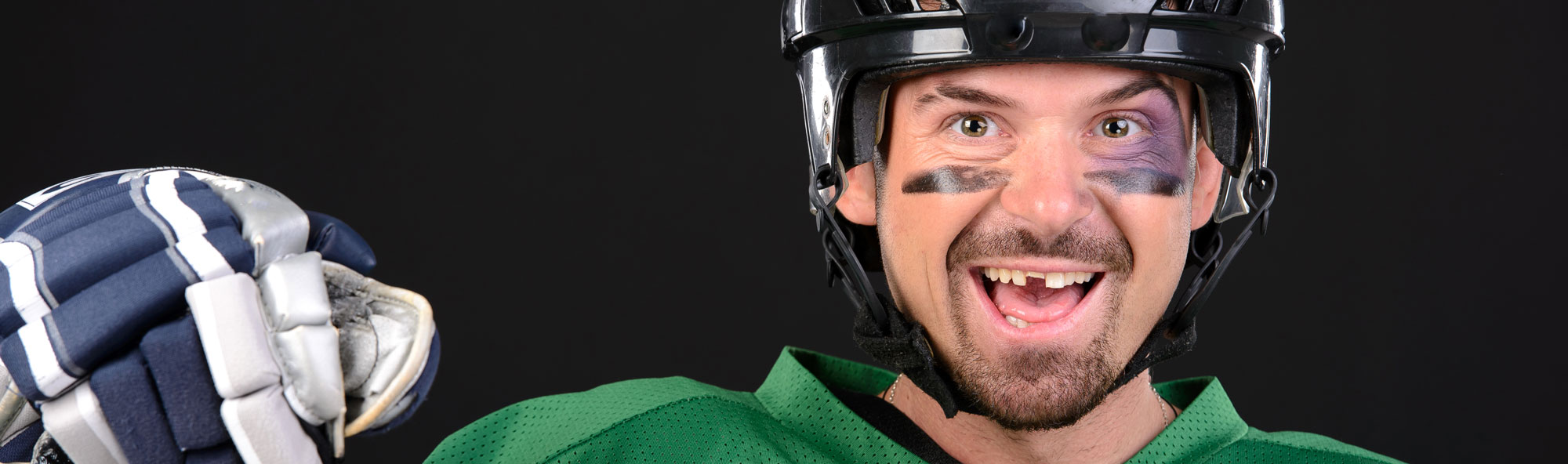 hockey player missing a tooth and smiling